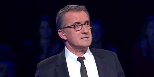 Christophe Dechavanne pourquoi porte-il des lunettes dans The Wall